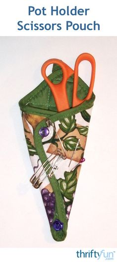 This is a guide about making a potholder scissors pouch. A pretty or seasonal potholder is the first step in making a simple scissors pouch.