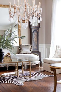 Beautiful details with the rug and gorgeous chandelier