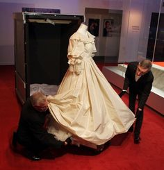 Dress handler Graeme Murton guards Princess Diana's wedding dress under the strictest of royal rule. With ten-thousand sequins and more than one hundreds of yards of tulle building skirt, it's an incredibly intricate gown but appears light and delicate in person.  The dress travels in a tall wooden crate, wrapped in a cloth. It's packed away without any accessories, like the 25 foot long train or the jeweled tiara and veil. The gown has travelled the world as part of Diana: A Celebration.