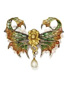 Attributed to Gaston Lafitte | Art Nouveau Gold, Plique-à-Jour Enamel, Diamond and Pearl Brooch. France, Circa 1900. Designed as a winged female figure, the wings applied with orange to green plique-à-jour enamel, accented by rose-cut diamonds, the pendant set with an old European-cut diamond and a pearl.