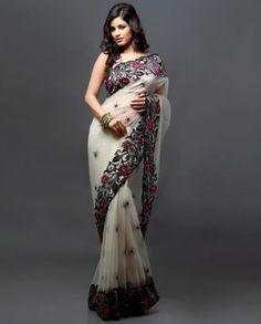 Cream sari with diamante work    http://www.barcode91.com/cream-sari-with-diamante-work.html