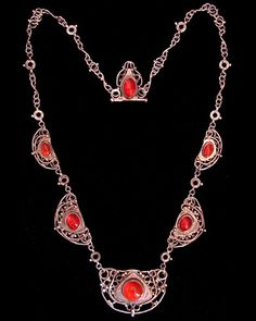 This is not contemporary - image from a gallery of vintage and/or antique objects. FRANCES MacNAIR (1873-1921)  A rare, important, Glasgow School, silver wirework necklace set fire opals.