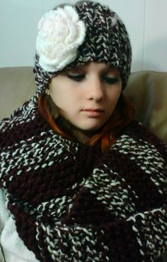 Scarf and ear warmer knit in a maroon and white yarn, rose crocheted in white yarn , both done by Jodi Villanella