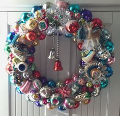 19 and chock full of Christmas treasures of all colors! I love giving old ornaments new life by bringing them together with other Christmas elements in my wreath arrangements. My wreaths are made with mostly vintage and some new materials. Ornaments may show oxidation, crackling, color and silvering loss--in other words, they are full of character! Photography does not capture the beautiful luminosity and unique colors of this old glass. I know you will be even more delighted when you see…