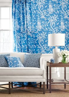 Pagoda Garden Fabric A striking printed fabric depicting a fantasy Oriental scene with gracefully arching trees, birds, and pagodas, shown in shades of blue.