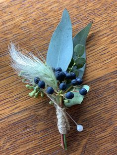 Blue Viburnum Berries, bunny grass, eucalyptus accented with twine.