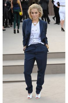 """""""Talk about moral support—Rita's super cool tee features an illustration of her best friend Cara! We love how she's wearing it half-tucked in for a slouchy yet styled look. Worn underneath a tailored, petrol-blue suit accessorized with chunky jewels and cool white heels, this edgy ensemble packs plenty of fashion cred."""""""