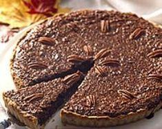 Tarte chocolat et noix de pécan : http://www.cuisineaz.com/recettes/tarte-chocolat-et-noix-de-pecan-5580.aspx