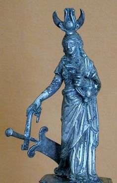 isis_fortuna. Silver statuette of the goddess with syncretic symbolism: the attributes of Isis (uraeus--cobra--headdress, small bucket on arm) and Fortuna (ship's rudder). Roman, 1st century CE. Naples, National Archaeological Museum.