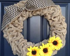 Burlap wreaths are a classic addition to your home decor!    This wreath is made with wide burlap ribbon on an 18-inch wire frame. Different sizes are available upon request.    It is adorned with a beautiful, large yellow burlap bow and sunflowers....perfect for summer!!    As with all of my products, this can easily be customized. Just message me if you would like a different color, pattern, size, etc.    I hand-tie all adornments onto my wreaths, so they can easily be changed for each…