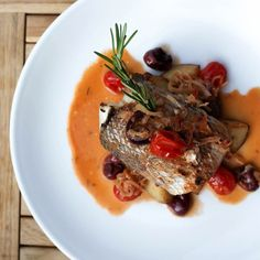 Orata Rollata: rolled sea bream filet with crab meat, grape tomatoes, Gaeta olives, red potato, and white wine sauce.