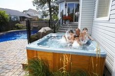 Paver stones provide a durable and attractive base for a hot tub.