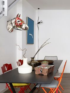 Put a decorative trofee on the wall. This one is from MIHO.  http://www.mulvdarp.dk/shop/miho-233c1.html