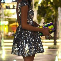 silver sequin sparkle dress - backless - glamour - party dress - Christmas - New Years Eve - event wear - colourful clutch bag - metallic
