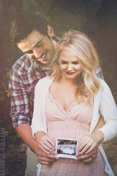 """""""Emma and Killian announcing the newest addition to their family. """""""