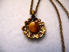 Vintage Pendant designed by Hannu Ikonen (Finland).  The Pendant is 1,5 cm x 2 cm.  The chain is 40 cm.  In perfect Condition.