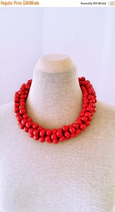 Check out this item in my Etsy shop https://www.etsy.com/listing/474038922/moving-sale-wooden-beads-necklace-bold