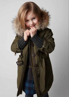 Love this kid's parka! It's a great layering tool and something that can easily be removed to reveal another outfit underneath!