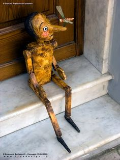 Pinocchio hand-made wooden puppet with a dragonfly on the nose - lovedesign
