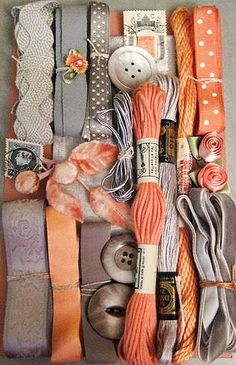 Collection of orange and neutral ribbons, trims, and other notions