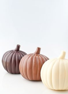 Chocolate pumpkins, available in white, milk, and dark chocolate.