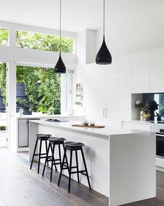 // STYLED by our bestie @aimeestylist ;) Love the SMOKED MIRROR splash back in the home of Melbourne's @showponyinteriors for @adoremagazine. Photo by the lovely @gemmola! :) Team DS. X #designstuff #kitchen #kitchendesign #kitcheninspo #kitcheninspiration #kitchenstyling #adoremagazine #mirrorsplashback #blackbarstools #whitecabinetry #naturallight #melbourne #australianinteriors #interiorinspiration #blackpendants #highceilings