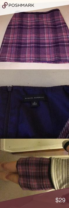 """Banana republic pencil skirt- Pink and Purple This skirt is technically a size two, but I am a size 8 in jeans and have been wearing it for a while.  It's in great shape- purple and pink plaid pattern. Wool knit and satin purple lining. Normally falls just above my knee, but it's more like a pencil mini as the waist is around my bellybutton. For smaller women it will probably hang lower. I've styled it with other items (sold separately) in my shop. Love it? Hit """"make offer""""— reasonable…"""