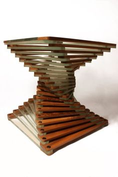 Walnut and glass layers flowing along a Fibonacci spiral bring this modern coffee table design to life. Designed and made in Surrey (UK) fusing state of the art and classical techniques. Dimensions of pictured table; Coffee table width = 400mm Coffee table length = 400mm Coffee