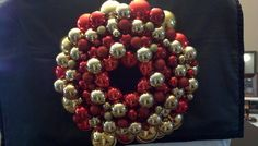 Red and gold Christmas ornament wreath by HumerusHewy on Etsy, $45.00