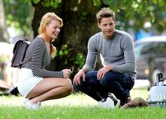 Margot Robbie and new boyfriend Tom Ackerley play with a ferret in a London park