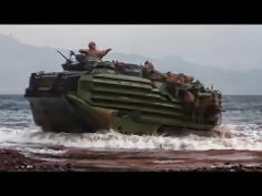 U.S. Marines of Company K, Battalion Landing Team 3/2, 26th Marine Expeditionary Unit (MEU), ride ashore from the USS Carter Hall (LSD 50) aboard amphibious assault vehicles during sustainment training in the 6th Fleet area of operations, Aug. 1, 2013.