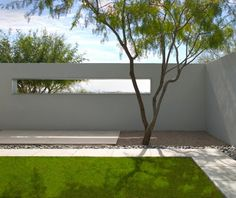 Contemporary minimalist garden design with constructed window.