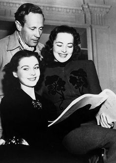 Vivien Leigh, Leslie Howard, and Olivia de Havilland look over a script for Gone With the Wind ""