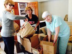 Preparing for registration: SOHA Treasurer Barbara Tabach, SOHA President Caryll Dziedziak, and SOHA member Myrna Wood stuffing conference bags