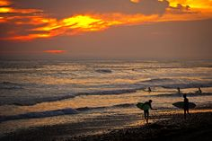 Surfers at sunset in Oceanside  July 2, 2013