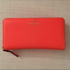 Kate Spade Cedar Street Lacey Authentic kate spade wallet in decent condition - It's been loved! The outside has spots where it looks worn but the inside is clean. The color is bright coral. kate spade Bags Wallets