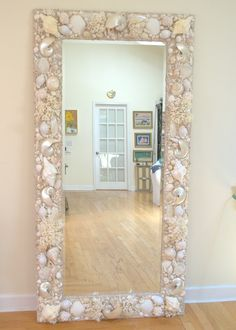 White and Cream seashell and coral mirror. Custom 6' x 3' $4700.00 WWW.EiegantShells.com
