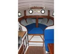 Small sailboat interior. White walls.