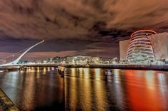 Dublin at night, converted to HDR.  You can purchase this photo at http://deanemcdermott.smugmug.com/Landscapes/My-World-My-Camera/i-42GxXk4/A  Thanks for looking!  Dublin, Ireland, Irish, HDR, Photography, Photograph, Landscape, Cityscape, NEX 6, Sony, Samuel Beckett Bridge, Dublin Convention Centre, River Liffey, Reflections,