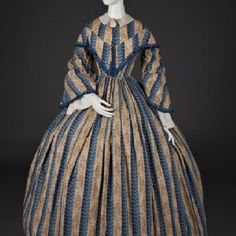 Woman's Dress, c. 1855-60 American Blue and light brown printed cotton Gift by contributions, 1946.288 This printed cotton dress represents a typical day dress of the 1850s. Slave labor in the South and underpaid mill workers in the North made it possible for consumers to purchase a wide range of inexpensive cotton fabrics in the antebellum era. The war, however, dramatically reduced the availability of southern cotton, which in 1860 accounted for 75 percent of the world's supply. Northern…