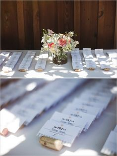 wedding escort cards in wine bottle corks #mintwedding #winecorks #weddingchicks http://www.weddingchicks.com/2014/01/03/mint-and-coral-wedding/