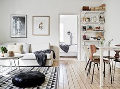 living interior wooden floors with white walls and very cool furniture