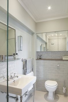 Pearlescent, light-reflecting tiles in subtle shades are an elegant solution in this cloakroom. MODS ceramic metro tiles in white, from £96.40 per sq m, are paired with mother-of-pearl rectangle mosaic in Panay, £301 per sq m from Surface Tiles.