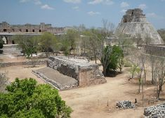 "This is part of the Maya city of Uxmal on the Western side of the Yucatan Peninsula along what is now called the ""Puuc route"" because of the hills in this area (""Puuc"" means ""hill"" in the Maya language).   On the right is The Pyramid of the Magician, in the center is one side of a ball court and at the top, left is a corbeled archway leading into a large square called The Nunnery"