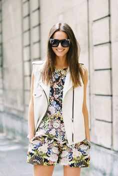 Go floral or go home.  In our opinion, the best way to pull off a romper is to nab one in an unapologetic floral print. To avoid looking a tad outlandish about it, you can tone it down with more subtle accessories, like fashion blogger Zina Charkoplia did with her white leather vest.