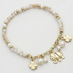 Lucky Ellie Bracelet in Ivory Crystals and Freshwater Pearls mixed with Elephant and Clover Charms.