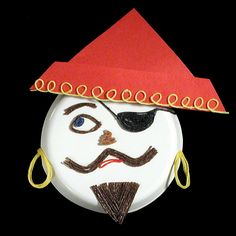Create paper plate faces with Wikki Stix! Hang them up for Halloween décor! #wikkistix #Halloween #craftsforkids