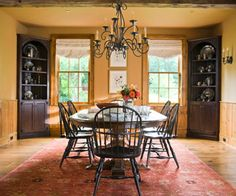 Love the warmth these colors add to the dining room - russet, clove & pumpkin.   The corner cabinets & wood beams!