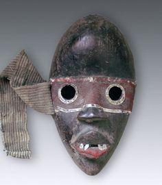 zakpai ge with blechumrandten eyes of Dan, Liberia  Mask zakpai ge of the Dan, Liberia Dainty mask in shape with blechumrandeten eyes and d...