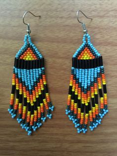 A personal favorite from my Etsy shop https://www.etsy.com/listing/261704024/mirsha-s-huichol-beaded-earrings-3-long